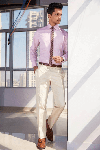 Pink is the new Black.. look suave in this pink shirt & light beige cotton trousers