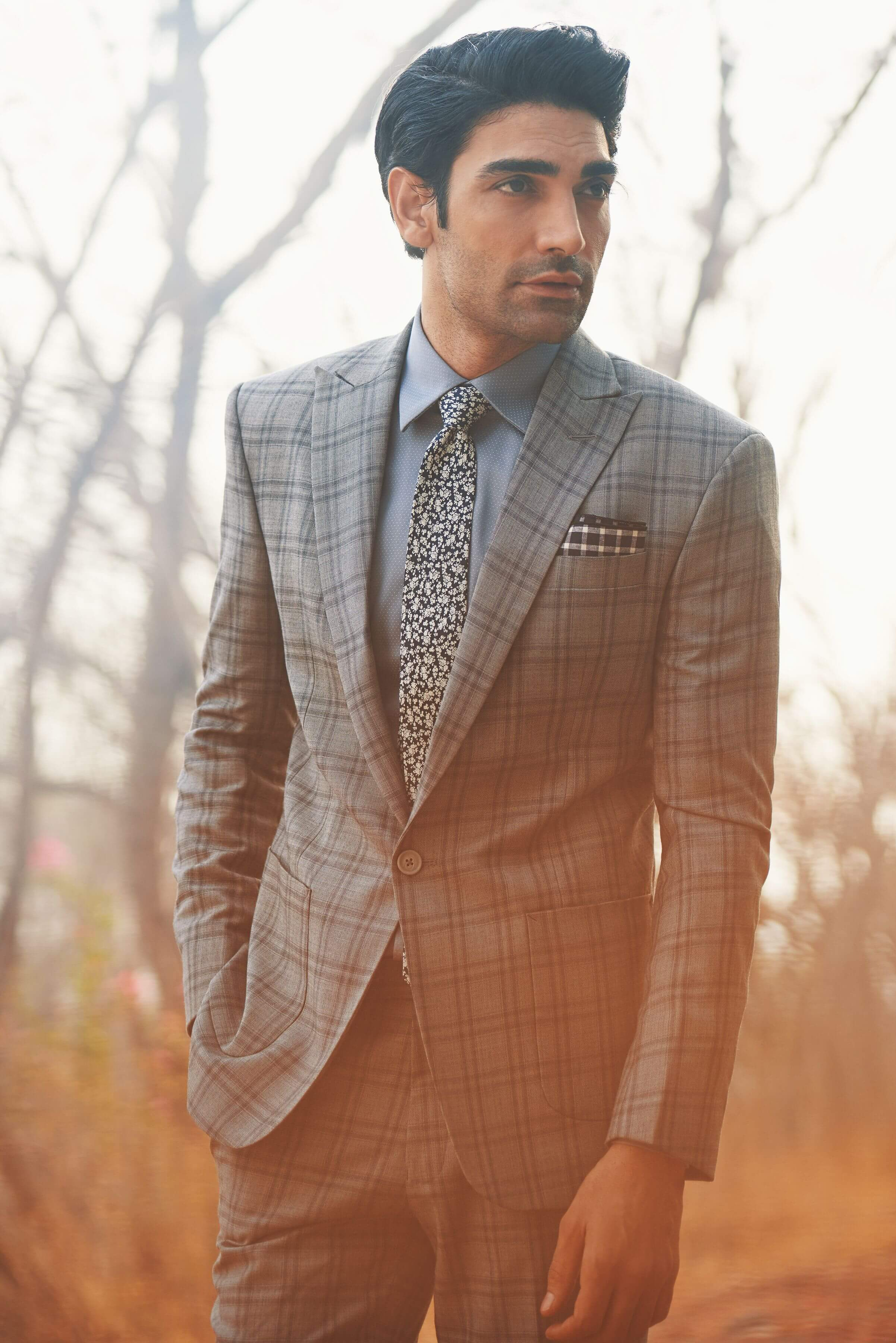 Classic single-button, single-breasted suit with a peak lapel
